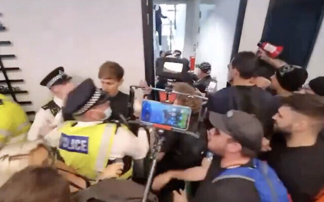 Anti-vaccine protesters break into the London headquarters of UK broadcaster ITN on August 23, 2021. (Screen capture: Twitter)