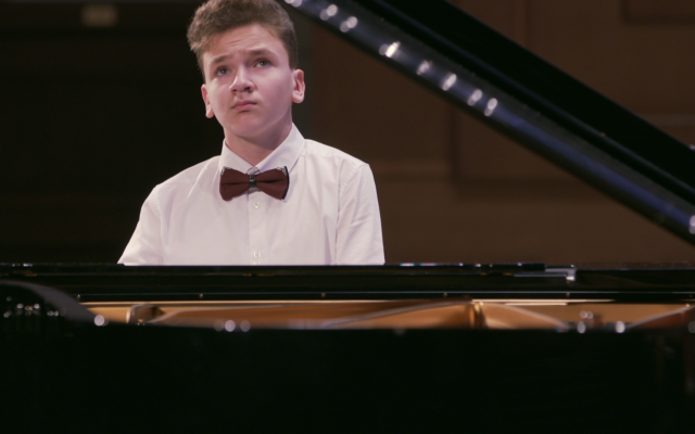 From 'The Pianist from Ramallah,' a documentary about Muhammad 'Misha' Alsheikh, a teenage pianist living between Palestinian, Russian and Jewish cultures, screening at the National Library of Israel's Docu.Text film festival, August 15-19, 2021 (Courtesy PR)