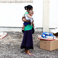 An Israeli woman outside a distribution center for needy people in Lod, September 11, 2012. Yonatan Sindel/Flash90)