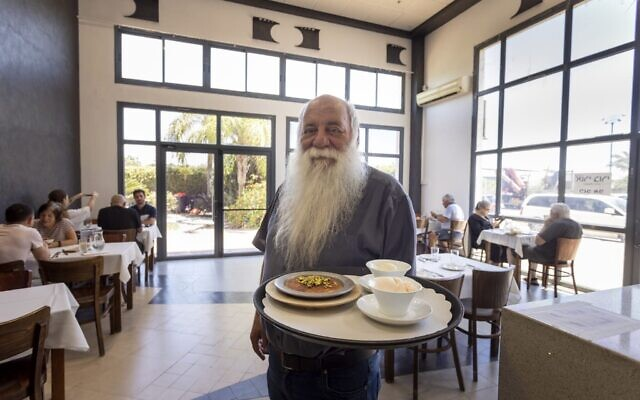 Uri Jeremias, owner of the famed Acre establishments Uri Buri and the Efendi Hotel, at his pop-up restaurant following the May 2021 firebombing at the original site that is currently being renovated.(courtesy, Uri Buri)