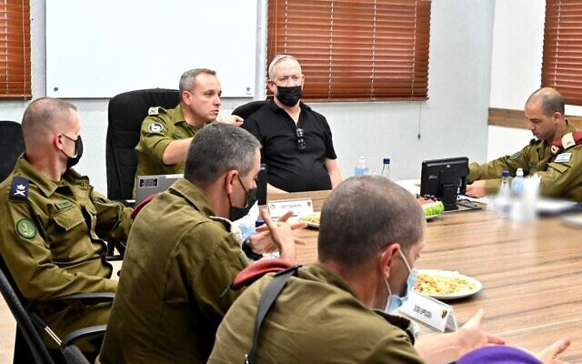 Defense Minister Benny Gantz meets with officers at the military's Gaza Division on August 3, 2021. (Ariel Hermoni/Defense Ministry)