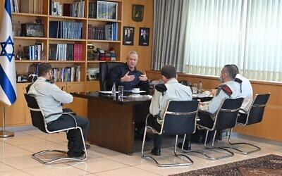 Defense Minister Benny Gantz meets with IDF Chief of Staff Aviv Kohavi and other top officers at the Kirya military headquarters in Tel Aviv on August 6, 2021. (Ariel Hermoni/Defense Ministry)