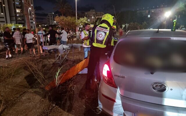 Medics are seen at the scene of the shooting in Bat Yam, August 9, 2021. (Magen David Adom)