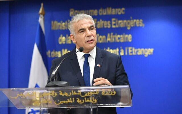 Foreign Minister Yair Lapid speaks at a ceremony with Moroccan Foreign Minister Nasser Bourita in Rabat, on August 11, 2021. (Shlomi Amsalem/GPO)