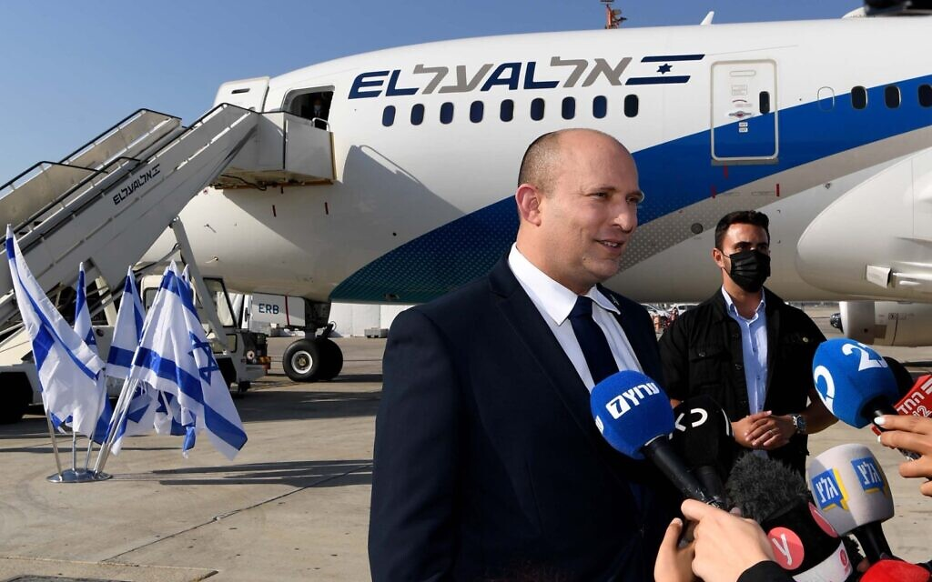 Prime Minister Naftali Bennett speaks to reporters before departing Ben Gurion Airport for Washington on August 24, 2021 (Avi Ohayon/GPO)