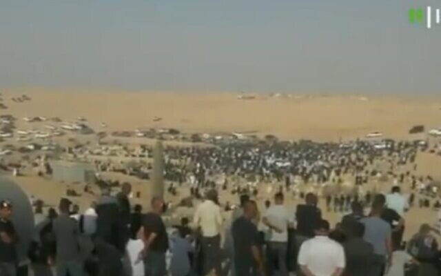 Thousands of mourners turn out for the funeral of Ra'am MK Said al-Harumi in Segev Shalom, on August 25, 2021. (Screenshot/Kan)