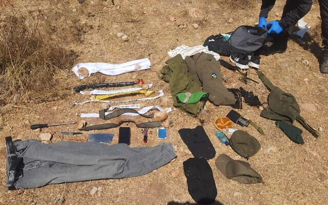 A Palestinian suspect, dressed up as an IDF soldier, was arrested while carrying a number of weapons, including a firearm, near the West Bank settlement of Ma'ale Levona, August 16, 2021. (Israel Defense Forces)