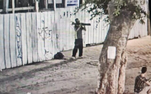 A homeless man is seen pointing a M72 LAW toward a store in Tel Aviv, August 14, 2021. (Israel Police)