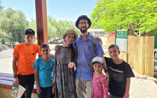 The Yitzchaki family with a 1,500-year-old coin they found at the Korazim archaeological site in northern Israel, August 10, 2021. (Dekel Segev/Israel Nature and Parks Authority)