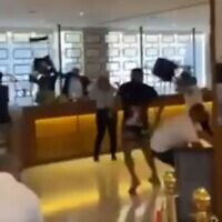 Hotel guests clash with employees at the Herbert Samuel hotel in downtown Jerusalem on July 31, 2021. (Screenshot)