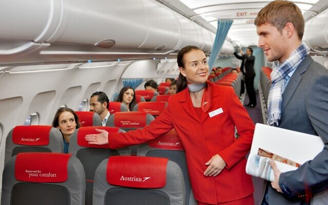 Illustrative: An Austrian Airlines flight attendant directing a passenger to his seat. (Austrian Airlines, CC BY-SA 2.0, Wikimedia Commons)