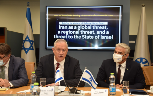 Defense Minister Benny Gantz (C) and Foreign Minister Yair Lapid (R) addressing foreign ambassadors at the Foreign Ministry, August 4, 2021. (Israel Foreign Ministry