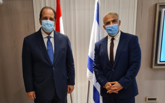 Foreign Minister Yair Lapid (right) meets with Abbas Kamel, director of Egypt's General Intelligence Directorate, in Jerusalem on August 19, 2021. (Foreign Ministry)
