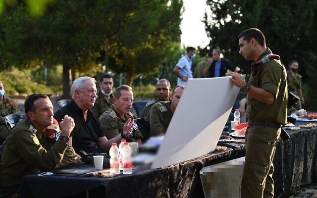 Defense Minister Benny Gantz speaks with military officials in the IDF northern command, on August 10, 2021. (Ariel Hermoni/Defense Ministry)