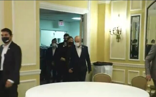Prime Minister Naftali Bennett arrives for a Friday evening sabbath service organized for the Israeli delegation at their Washington hotel, on August 27, 2021. (Screenshot/Channel 12)