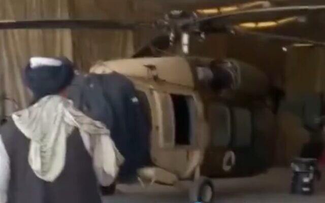 Taliban show off US-made Afghan military helicopters captured at Kandahar Airport, screen grab from video uploaded to Twitter on August 14, 2021.