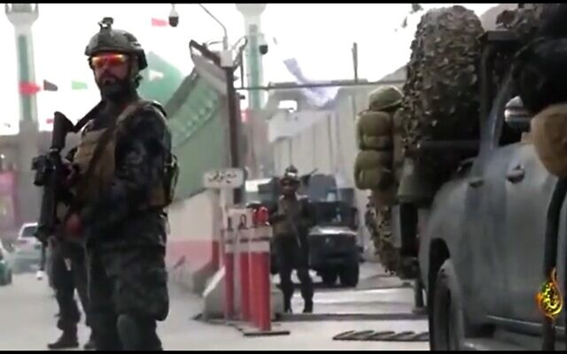 Taliban fighters show off uniforms and US-made rifles seized from former Afghan forces in video on social media. (Screenshot)