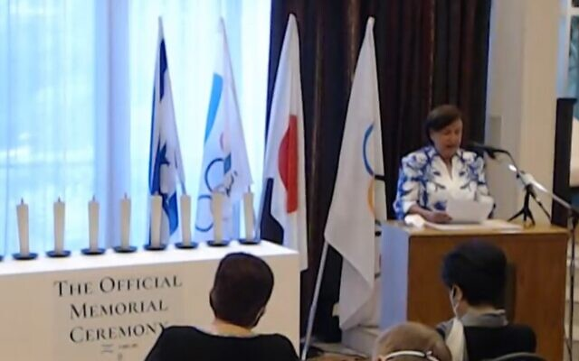 Ankie Spitzer speaks at the Israeli memorial for the victims of the 1972 Munich Olympics massacre, in Japan on August 1, 2021 (screen capture: Facebook)