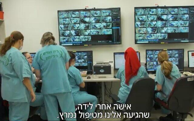 Nurses monitor patients in the coronavirus ward at Petah Tikva's Beilinson Medical Center (Screencapture/Channel 12)