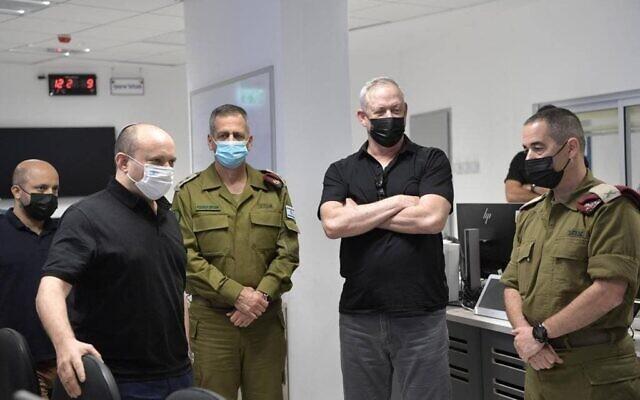 Prime Minister Naftali Bennett, Defense Minister Benny Gantz  and IDF Chief Aviv Kochavi tour the IDF Gaza Divison, on August 17, 2021. (Kobi Gideon/GPO)
