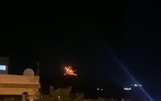 An explosion is seen in Syria after a projectile hit, near the border with Israel, on August 17, 2021. (Video screenshot/Twitter)