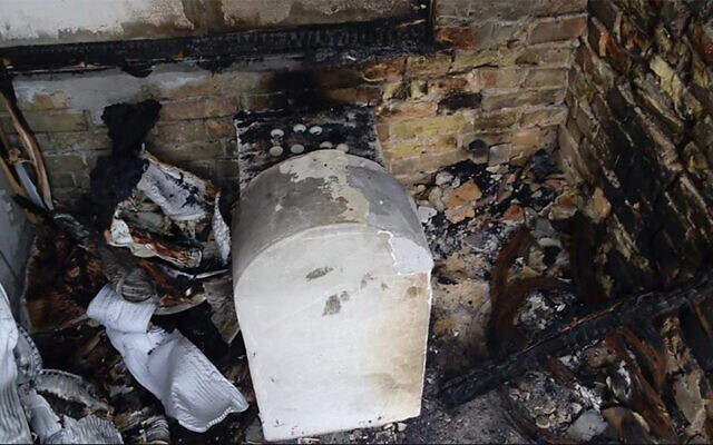 Illustrative: The grave of a daughter of Rabbi Nachman of Bratslav after it was torched in Kremenchuk, Ukraine, in 2015. (Oholei Tzadikim via JTA)