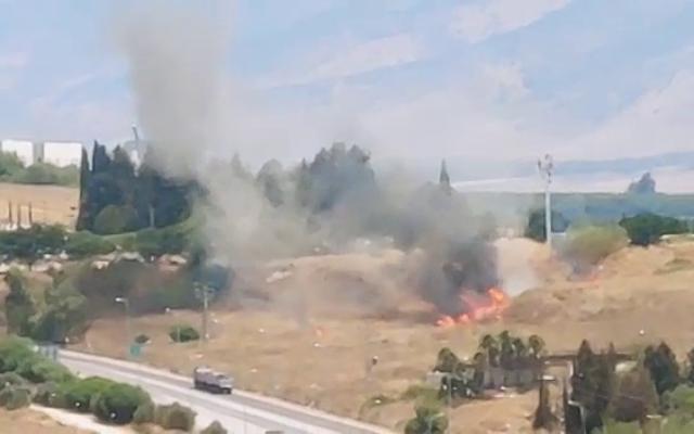 A fire is seen after a rocket landed in an open field near the northern city of Kiryat Shmona, on August 4, 2021. (video screenshot)