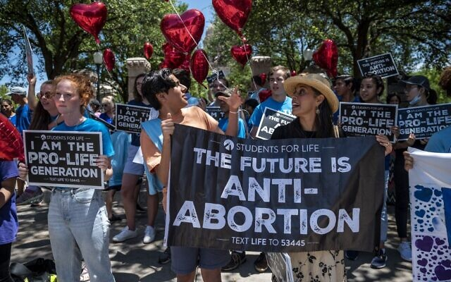 In this file photo pro-life protesters stand near the gate of the Texas state capitol at a protest outside the Texas state capitol on May 29, 2021 in Austin, Texas. (SERGIO FLORES/GETTY IMAGES NORTH AMERICA/AFP)