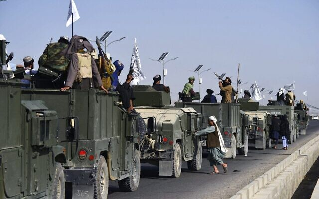 Taliban fighters atop Humvees prepare before parading along a road to celebrate after the US pulled all its troops out of Afghanistan, in Kandahar on September 1, 2021, following the Taliban's military takeover of the country. (Javed Tanveer/AFP)