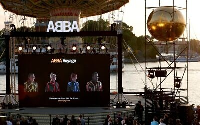 Members of the Swedish group ABBA are seen on a display during their Voyage event at Grona Lund, Stockholm, on September 2, 2021, during their presentation of the first new song after nearly four decades. (Fredrik PERSSON / TT News Agency / AFP)