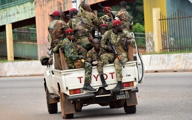 Members of the Guinean armed forces drive through the central neighborhood of Kaloum in Conakry on September 5, 2021, after sustained gunfire was heard. (Cellou Binani/AFP)
