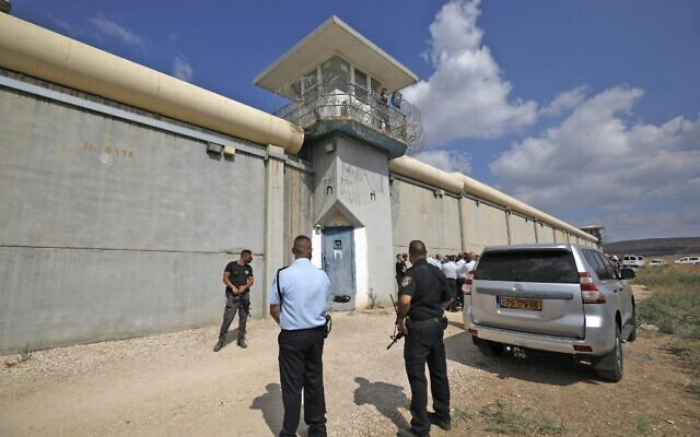 Israeli security personnel gather outside the Gilboa Prison in northern Israel on September 6, 2021. (Jalaa MAREY / AFP)