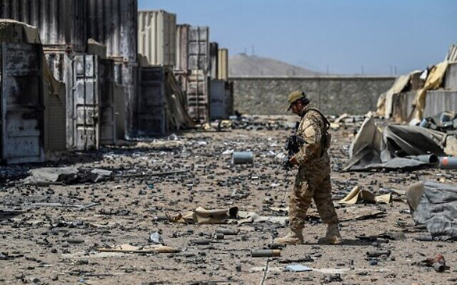 A member of the Taliban Badri 313 military unit walks amid debris of the destroyed Central Intelligence Agency (CIA) base in Deh Sabz district northeast of Kabul on September 6, 2021 after the US pulled all its troops out of the country. (Photo by Aamir QURESHI / AFP)