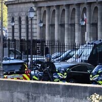 French Gendarmes escort a convoy understood to be transporting Salah Abdeslam, the prime suspect in the November 2015 Paris attacks, upon its arrival at the Palais de Justice of Paris, September 8, 2021. (Thomas Coex/AFP)