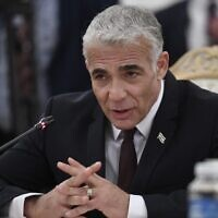 Foreign Minister Yair Lapid attends a meeting with his Russian counterpart in Moscow on September 9, 2021. (Alexander Nemenov/Pool/AFP)