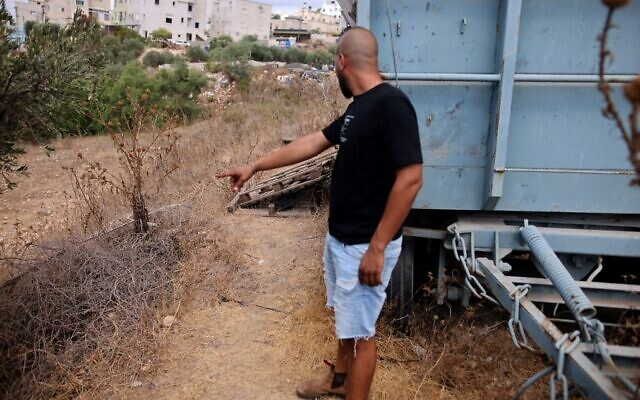 A man points at the spot where an escaped Palestinian security prisoner  was recaptured in the northern Arab town of Shibli–Umm al-Ghanam on September 11, 2021. (Ahmad Gharabli/AFP)