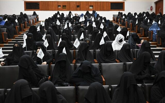 Veiled students hold Taliban flags as they listen a speaker before a pro-Taliban rally at the Shaheed Rabbani Education University in Kabul on September 11, 2021. (Aamir QURESHI / AFP)