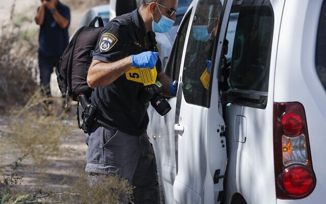 Members of Israeli security forces search a woodland area between the northern Israeli cities of Afula and Nazareth, on September 11, 2021, amid a manhunt for Palestinian jailbreakers. (Ahmad Gharabli/AFP)