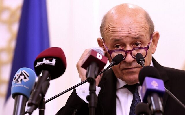 French Foreign Minister Jean-Yves Le Drian speaks during a joint press conference with his Qatari counterpart in Qatar's capital Doha, on September 13, 2021. (Karim Jafaar/AFP)