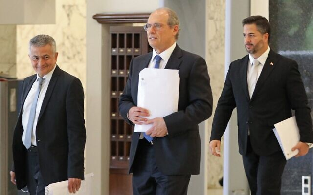 Lebanon's Finance Minister Youssef Khalil (L) and Minister of Economy Amin Salam (R) leave the presidential palace in Baabda, east of the capital Beirut, following a cabinet meeting on September 13, 2021. (ANWAR AMRO / AFP)
