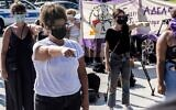 Cypriot women demonstrate on September 16, 2021 in front of Nicosia's supreme court, in support of a young British woman who alleged she was raped by up to 12 Israelis in a hotel room in the seaside party resort of Ayia Napa in July 2019. (Iakovos Hatzistavrou/AFP)