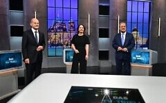 """Top candidates for the upcoming German general elections (L-R) Olaf Scholz of the Social Democrats SPD, Annalena Baerbock of Germany's Greens (Die Gruenen) and Armin Laschet of the conservative CDU/CSU party union pose for pictures before a """"Triell"""" television debate on September 19, 2021 in Berlin, ahead of Germany's general elections scheduled for September 26. (Tobias Schwarz / AFP)"""