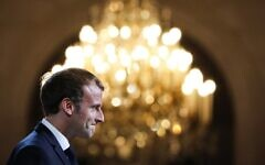 French President Emmanuel Macron reacts during a collective award ceremony for the Legion of Honor, at the Elysee Palace, in Paris, on September 20, 2021. (Stefano rellandini / POOL / AFP)