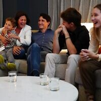 Canadian Prime Minister and Liberal leader Justin Trudeau (center) watches election results with wife Sophie Gregoire-Trudeau and children, Xavier, Ella-Grace and Hadrien, at Liberal headquarters in Montreal, on September 20, 2021. (Sean Kilpatrick/Pool/AFP)