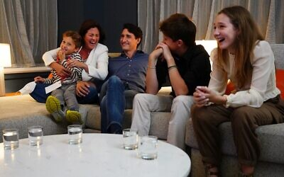 Canadian Prime Minister and Liberal leader Justin Trudeau (C) watches election results with wife Sophie Gregoire-Trudeau and children, Xavier, Ella-Grace and Hadrien, at Liberal headquarters in Montreal, September 20, 2021. (Sean Kilpatrick / POOL / AFP)