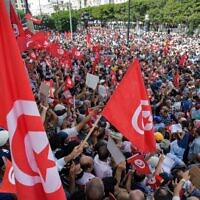 Demonstrators chant slogans during a protest in Tunisia's capital Tunis, on September 26, 2021, against President Kais Saied's recent steps to tighten his grip on power. (Fethi Belaid/AFP)