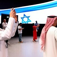 People take pictures in the Israel pavilion during a media tour ahead of the opening of the Dubai Expo 2020 in the Gulf Emirate on September 27, 2021 (AFP)