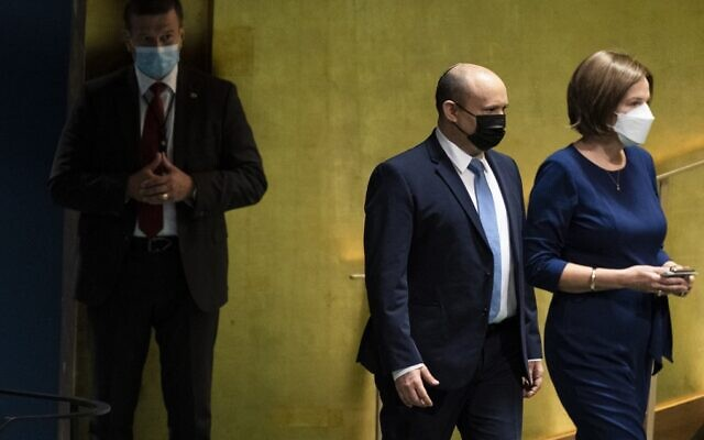 Prime Minister Naftali Bennett is escorted to the podium before addressing the 76th Session of the United Nations General Assembly, September 27, 2021, at UN headquarters in New York. (John Minchillo/Pool/AFP)