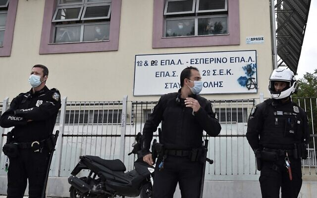 Police guard outside a vocational high school (EPAL) following clashes in the western suburb of Stavroupoli, in Thessaloniki, Greece, September 29, 2021. (Sakis Mitrolidis/AFP)