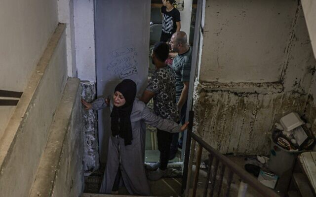 A relative mourns the death of Palestinian Mohammad Abu Ammar, 40, killed by Israeli troops near the separation fence with Israel, during his funeral in the refugee camp of Bureij, in the Gaza Strip, on September 30, 2021. (Mohammed Abed/AFP)